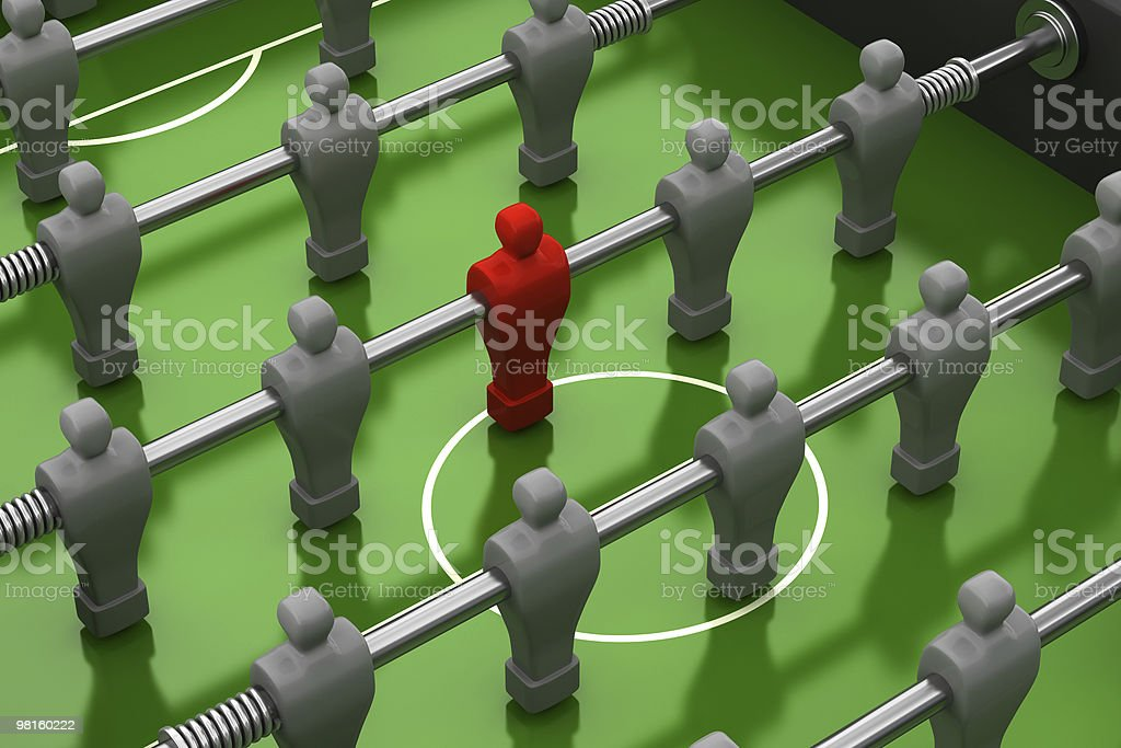 foosball table with red player among the identical royalty-free stock photo
