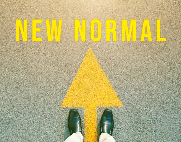 """foot and arrow on the road that says """"new normal"""". concept new life after the outbreak of the covid-19 virus. - new normal foto e immagini stock"""