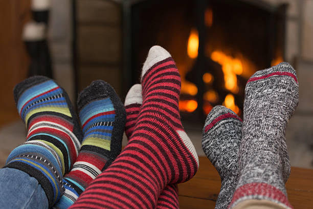 Foot and Suck Behind Fireplace Foot and Suck Behind Fireplace apres ski stock pictures, royalty-free photos & images