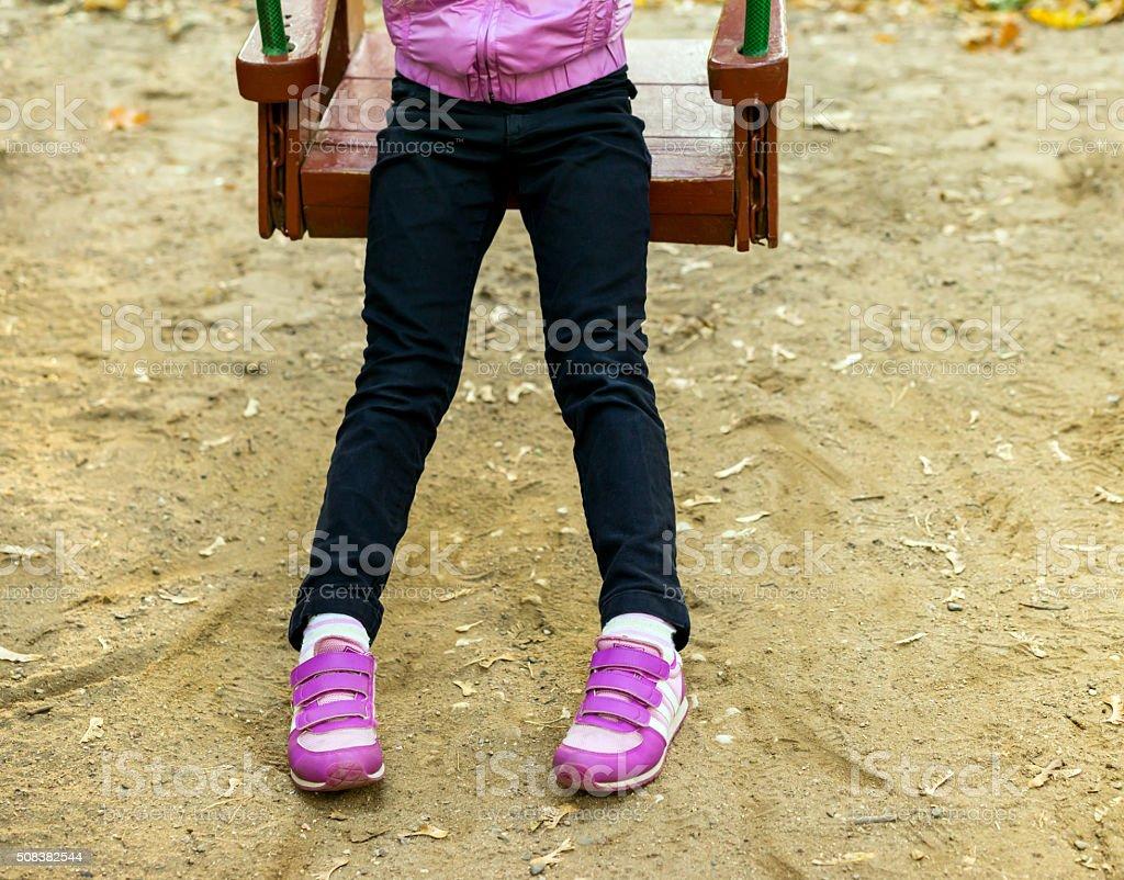 Foot baby on swing stock photo