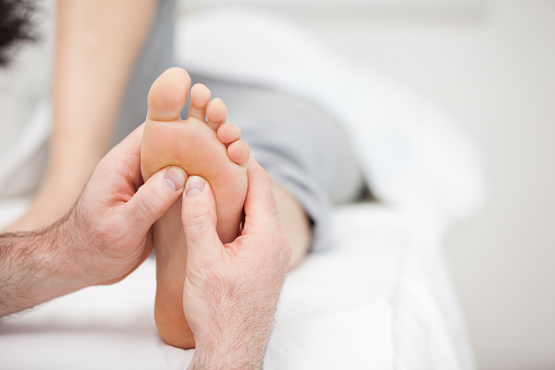 Foot Being Massaged On A Medical Table Stock Photo - Download Image Now