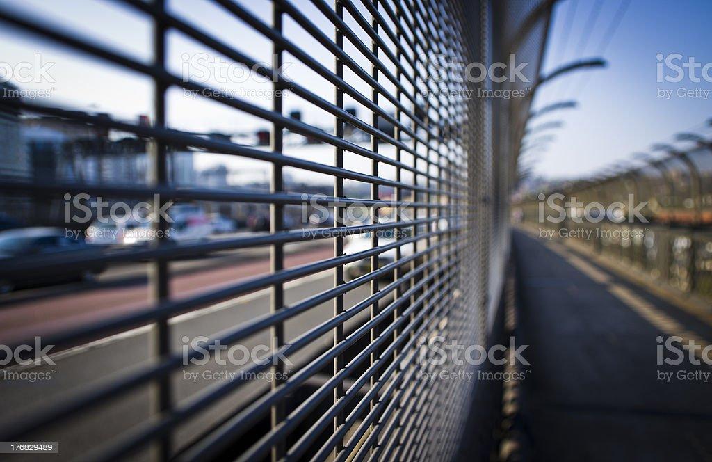 Foot bridge next to road royalty-free stock photo