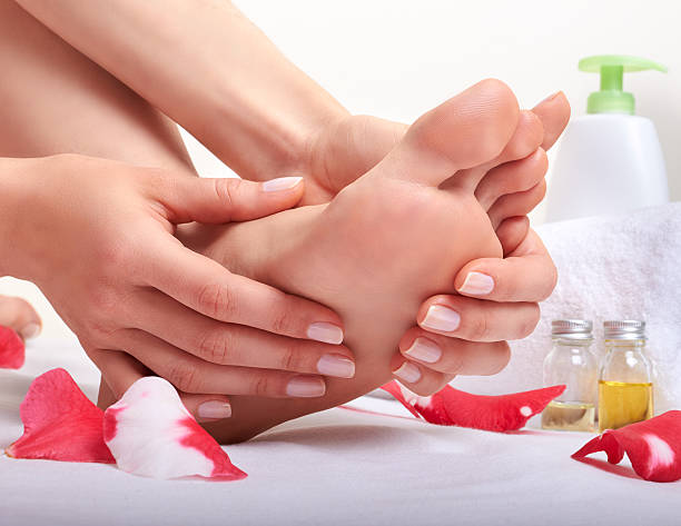 Foot care and massage for the better stock photo
