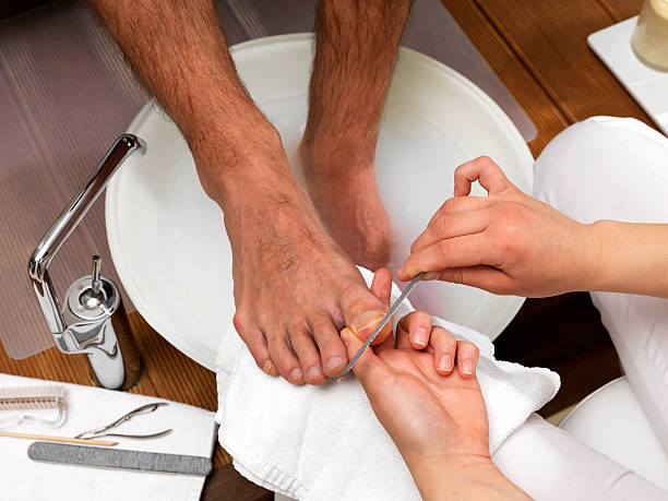 Foot Care (Click for more) Men's Foot Care In The Beauty Parlour (Pedicure) pedicure manicure men beauty spa stock pictures, royalty-free photos & images