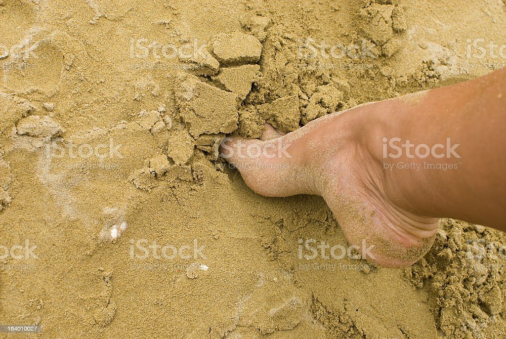Foot in the sand stock photo