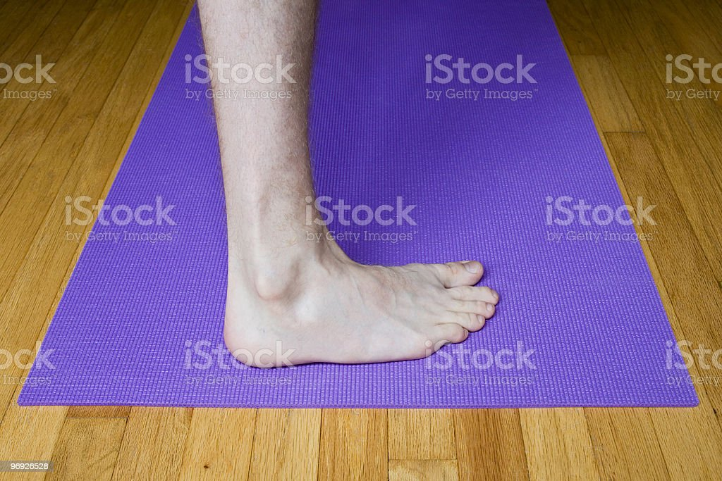 Foot in Warrior Pose royalty-free stock photo