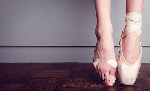 foot injured ballerina stock photo