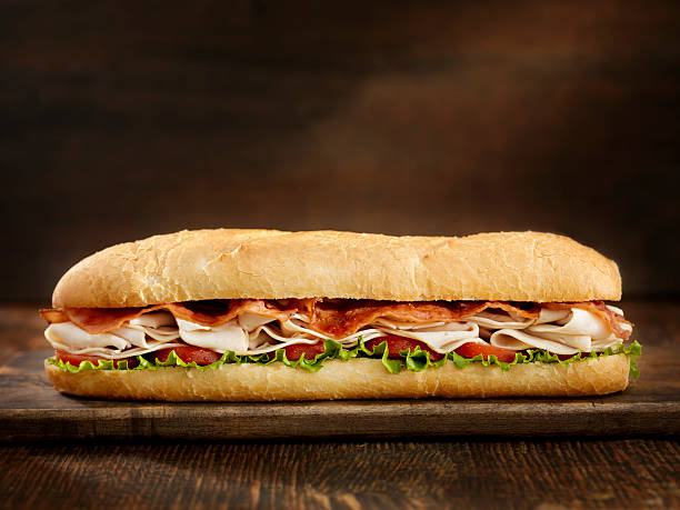 Foot Long Turkey and Bacon Sub  submarine sandwich stock pictures, royalty-free photos & images