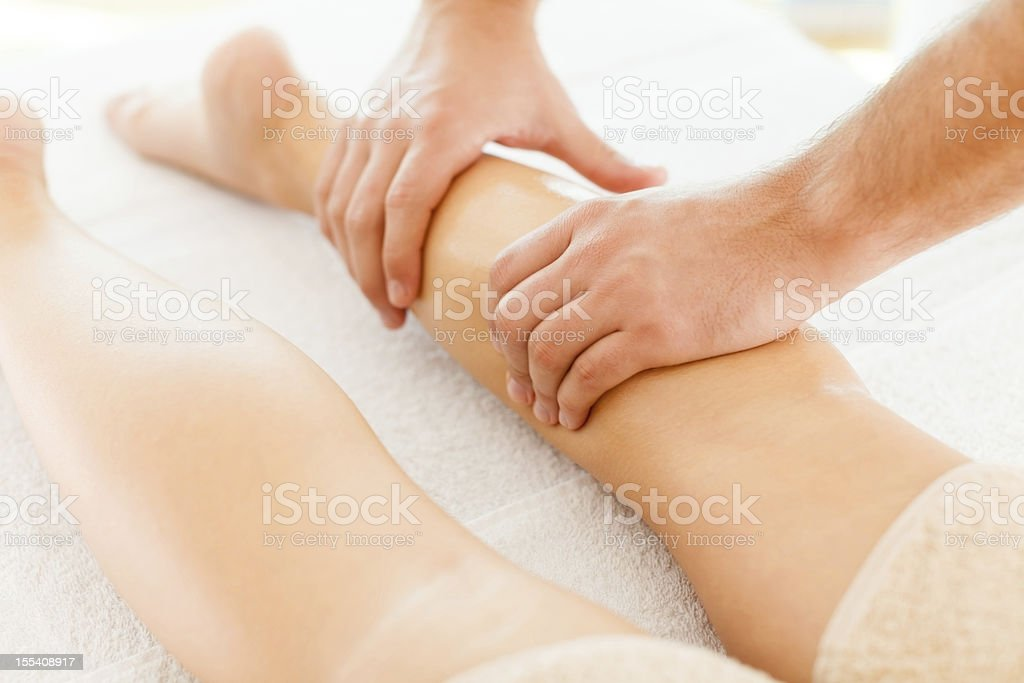 Foot massage in the spa salon royalty-free stock photo