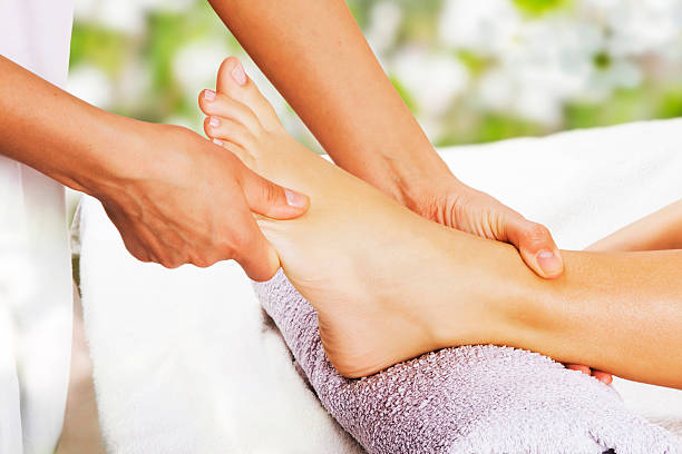Foot massage in the spa salon Foot massage in the spa salon in the garden foot massage stock pictures, royalty-free photos & images