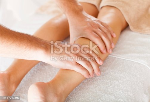 istock Foot massage in the spa salon 161776950