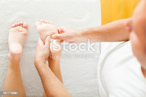 istock Foot massage in the spa salon 161776961