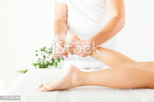 istock Foot massage in the spa salon 161792259