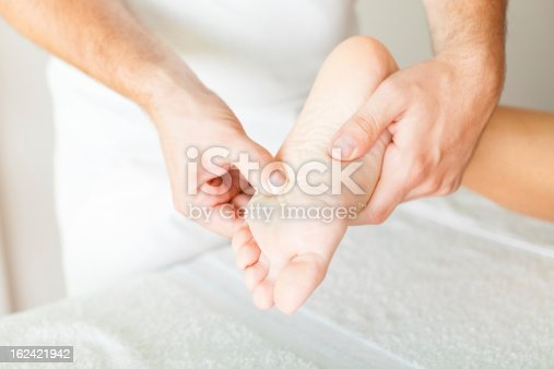 istock Foot massage in the spa salon 162421942