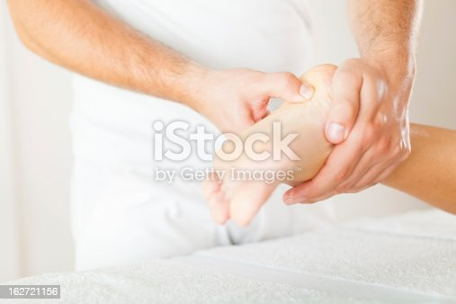 istock Foot massage in the spa salon 162721156