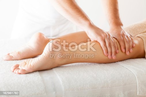 istock Foot massage in the spa salon 162961762