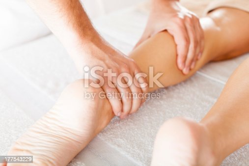 istock Foot massage in the spa salon 177543229