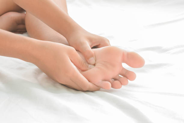 foot massage   in women stock photo