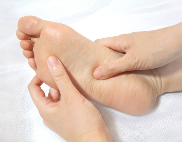 Foot massage Massaging the sole of the foot with fingers. sole of foot stock pictures, royalty-free photos & images