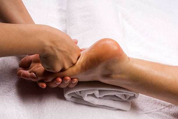 foot massage - thai massage stock photos and pictures