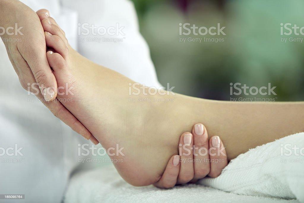 Foot massage stock photo