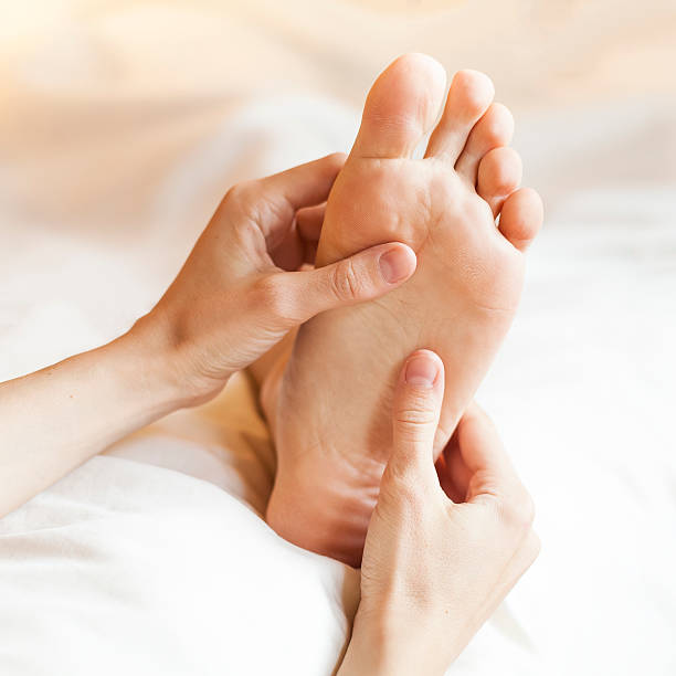 Foot massage Thai foot massage with hands and thumbs foot massage stock pictures, royalty-free photos & images