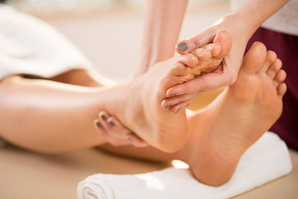 Foot massage Close-up of young woman's foot massage foot massage stock pictures, royalty-free photos & images