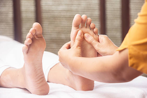 Foot massage Foot massage foot massage stock pictures, royalty-free photos & images