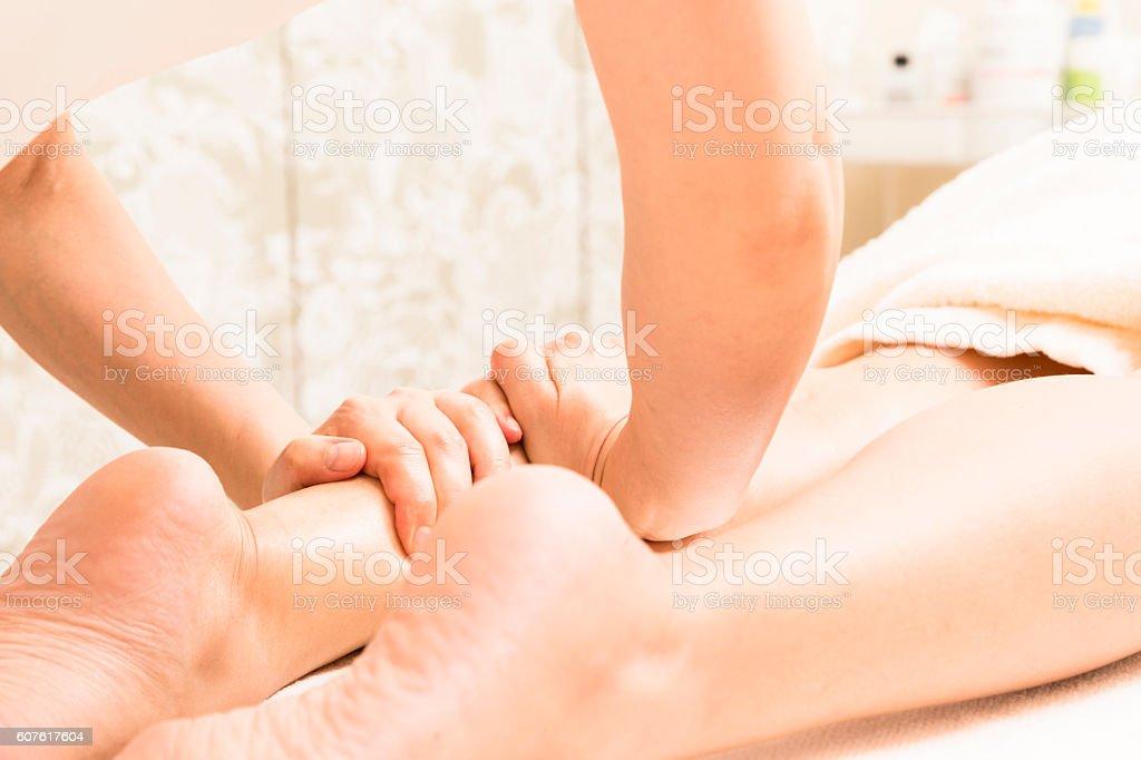 Foot massage treatment to the oriental women ストックフォト