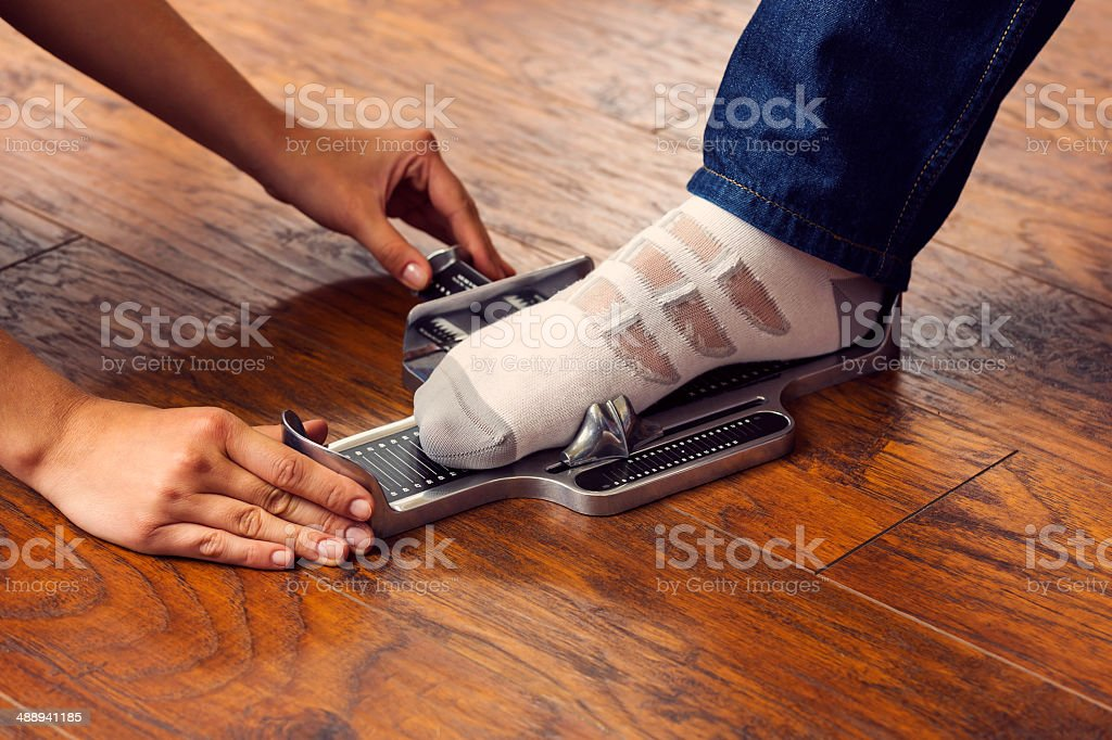 Foot measuring stock photo