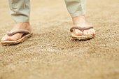 Foot of elderly man in Zouri