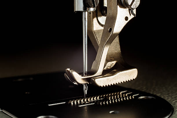 foot of the sewing machine - sewing machine needle stock photos and pictures