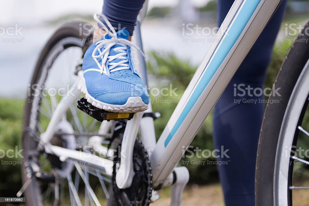 Foot on a bicycle pedal stock photo