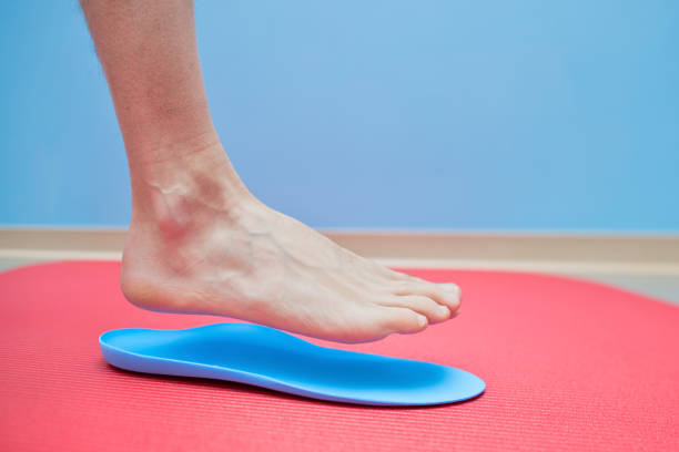 Foot on orthopedic insoles medical foot correction Foot on orthopedic insoles medical foot correction. foot stock pictures, royalty-free photos & images