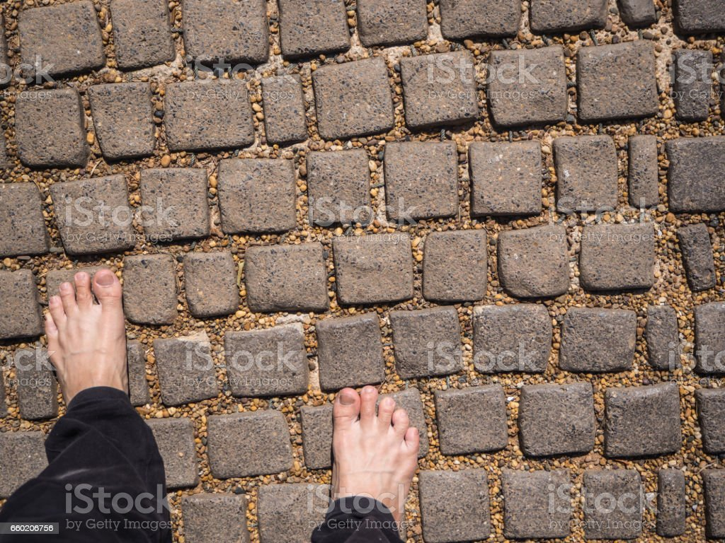 foot on pebble and stone background stock photo