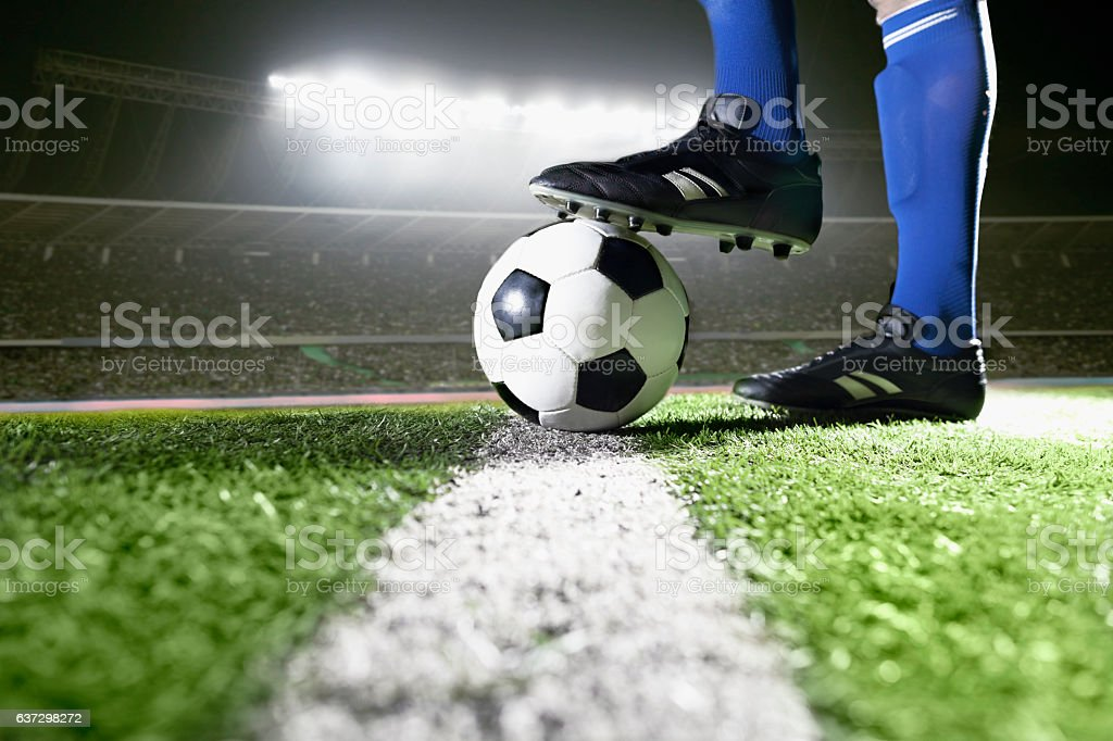 Foot on soccer ball mid field line - foto de stock