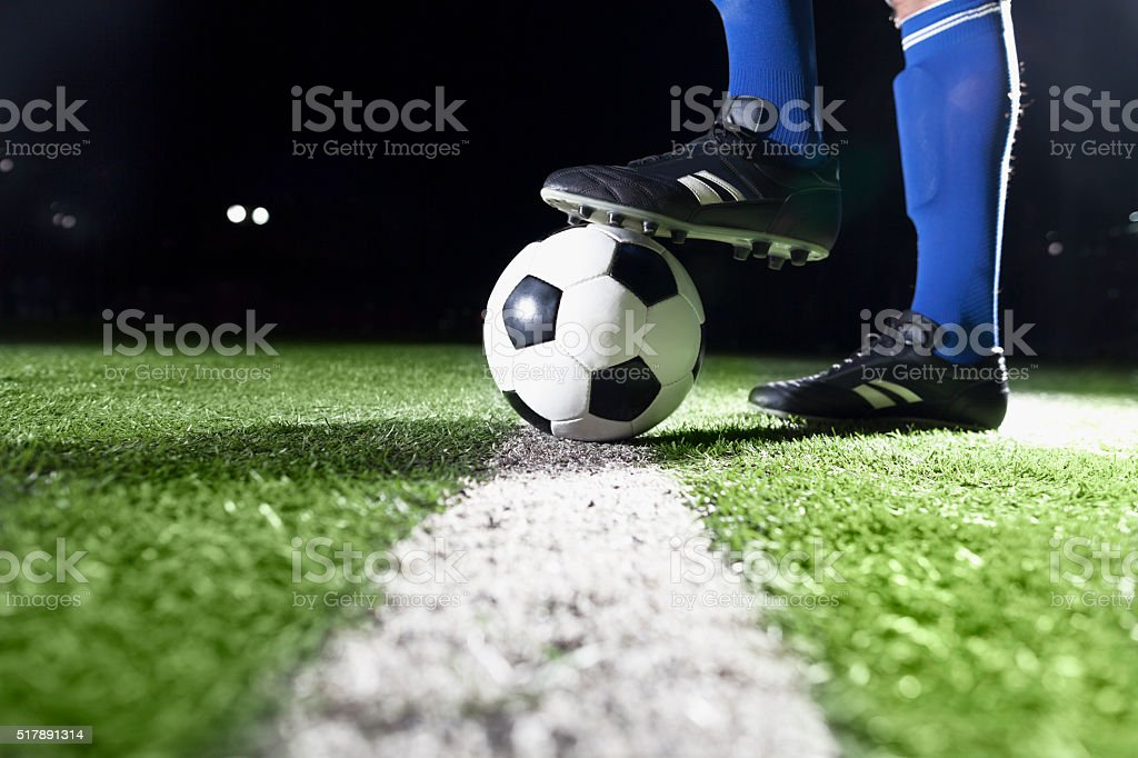 Foot on soccer ball stock photo