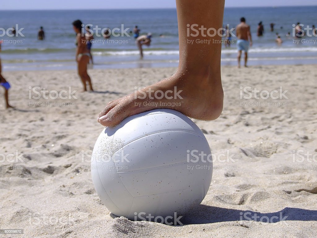 Foot on the volleyball royalty-free stock photo