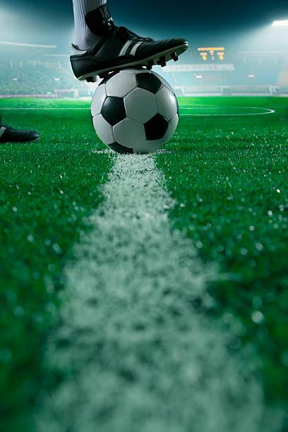 Fuß auf der Oberseite der Fußball-Spielball – Foto