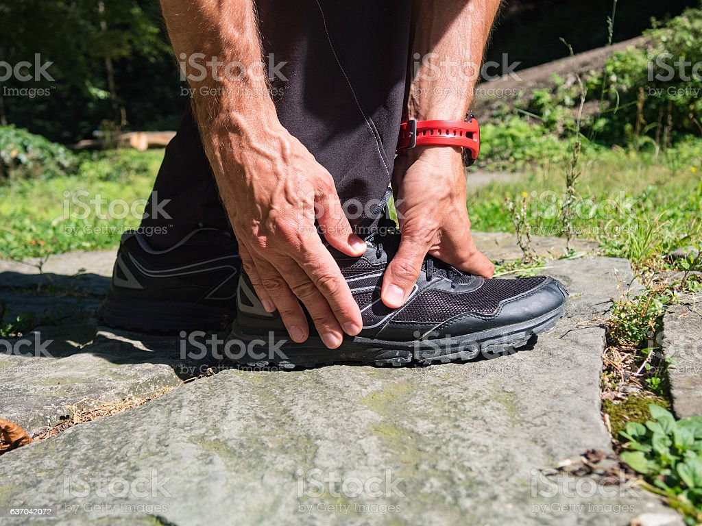 Foot pain from running stock photo