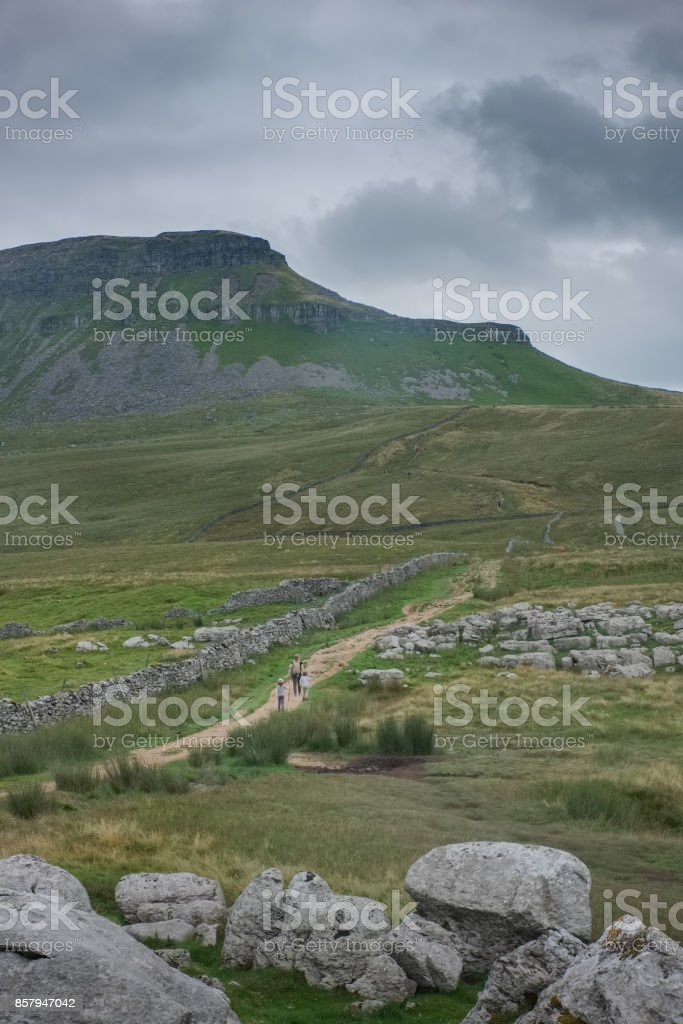Foot path to Pen-y-Ghent on overcast day in North Yorkshire, England stock photo