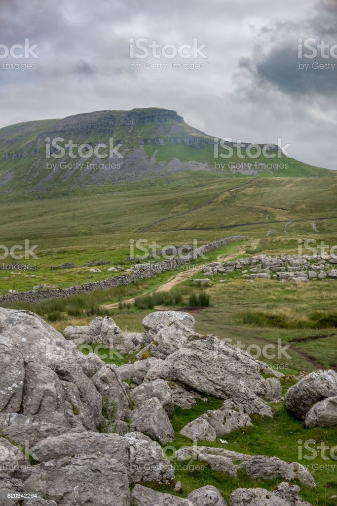 Foot path to Pen-y-Ghent on overcast day. stock photo