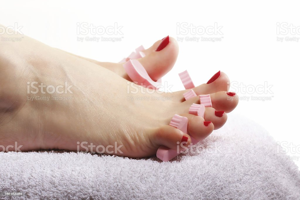 foot pedicure applying red toenails on white royalty-free stock photo