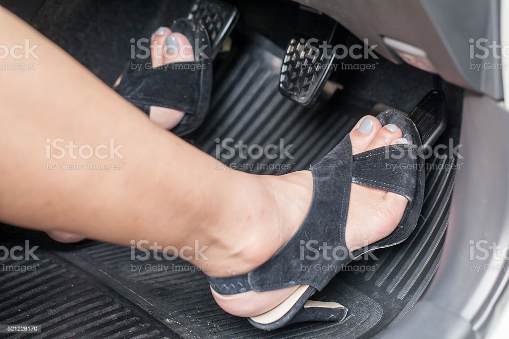 foot pressing the accelerator pedal stock photo