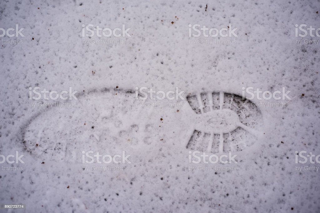 Foot prints in the snow stock photo