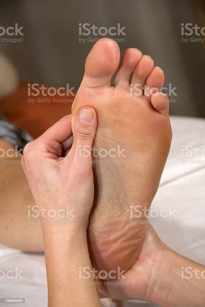 foot reflex zone massage royalty-free stock photo