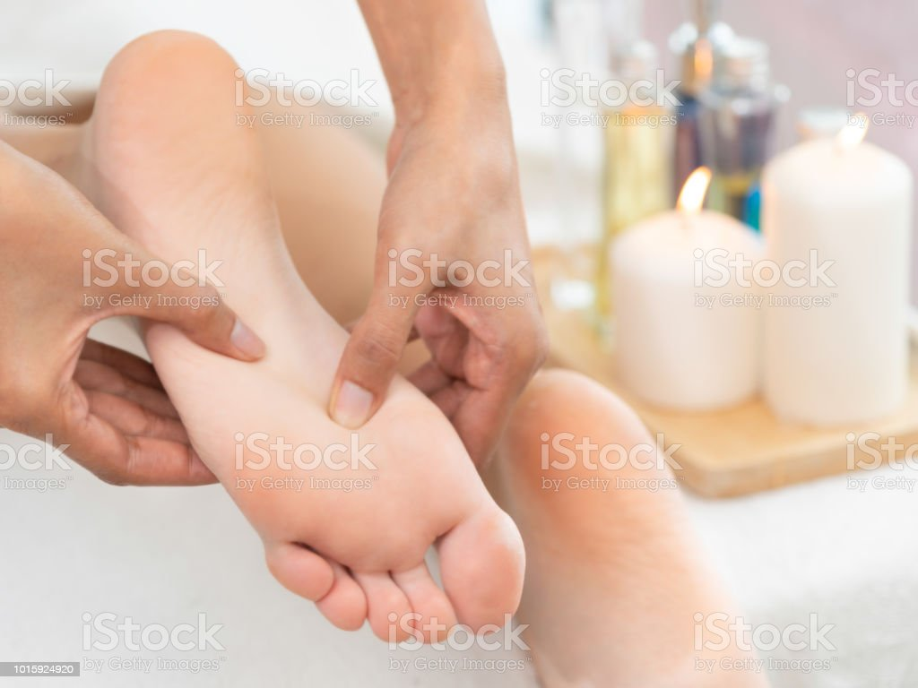 Foot spa massage treatment in luxury spa resort. stock photo