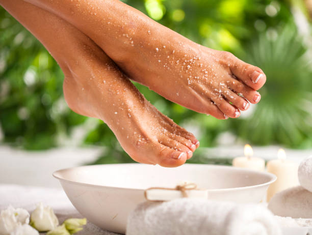 Foot spa on a tropical green leaves background stock photo
