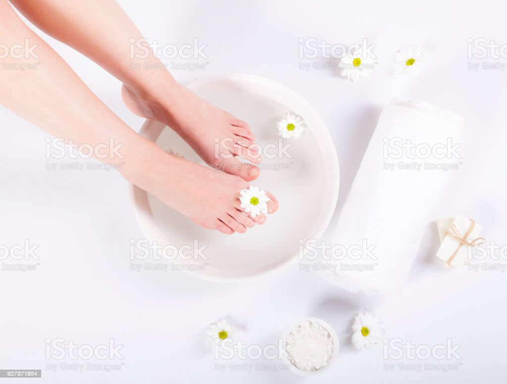 Foot spa on white background - Royalty-free Adult Stock Photo