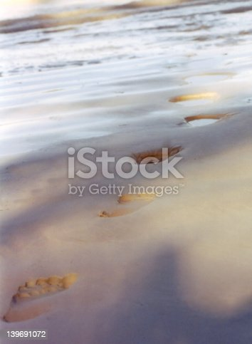 istock Foot steps into the ocean. 139691072